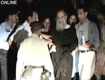 maulanaaziz-in-custody.jpg
