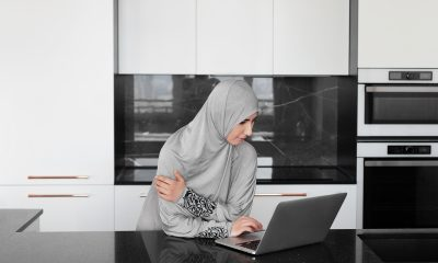 Muslim woman on laptop sexual harassment