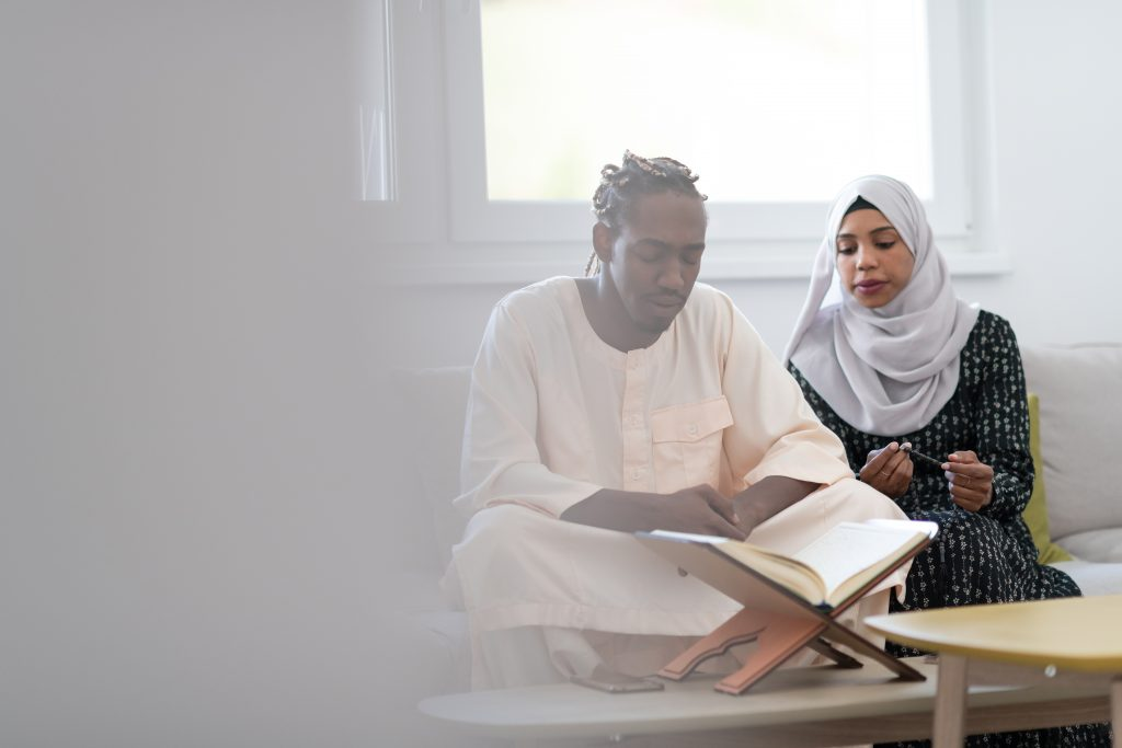 Muslim couple healing reciting Quran