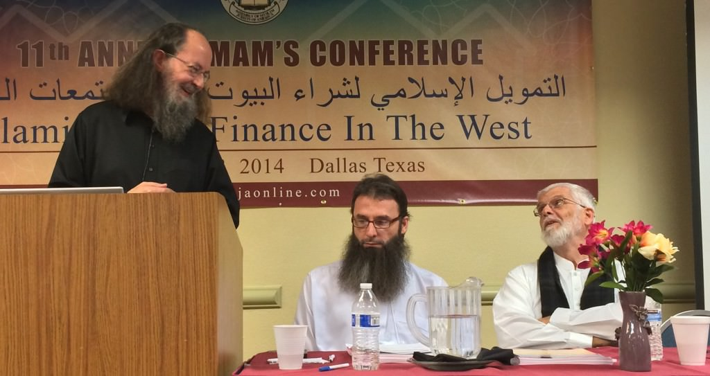 Shaykh Jamaal Zarabozo and Shaykh Yusuf Talal Delorenzo discussing the contract of Guidance Financial. Imam Sphendim Nadzaku moderating.