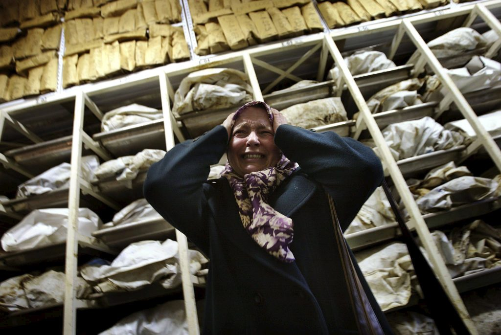 "Aida Civic, a Bosnian Muslim refugee woman from Srebrenica, screams as she enters a container with the remains of around 3,500 killed Bosnian Muslims, most of them from Srebrenica, in an identification centre of the Institute for missing persons in Tuzla in this December 10, 2002 file photo. Twenty years ago on July 11, 1995, towards the end of Bosnia's 1992-95 war, Bosnian Serb forces swept into the eastern Srebrenica enclave, a U.N.-designated ""safe haven"". There they took 8,000 Muslim men and boys and executed them in the days that followed, dumping their bodies into pits in the surrounding forests.     REUTERS/Damir Sagolj/Files  TPX IMAGES OF THE DAY FROM THE FILES PACKAGE ""SREBRENICA MASSACRE - 20TH ANNIVERSARY� SEARCH ""SREBRENICA MASSACRE� FOR ALL 15 IMAGES      TPX IMAGES OF THE DAY"