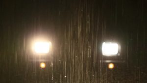 Car headlights in the rain