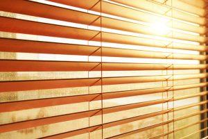 Sun through window blinds